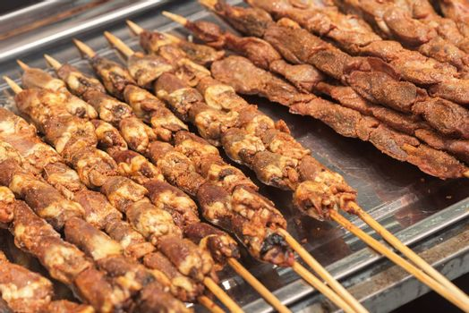 Street food asia. Meat on a stick.