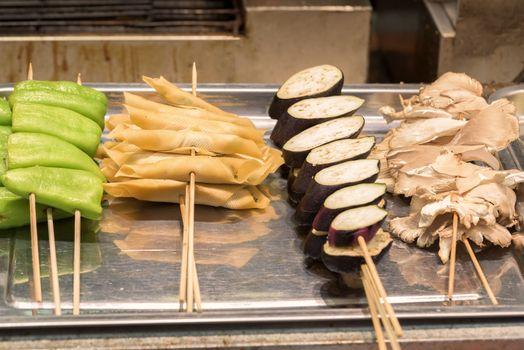 Street food asia. Street food on a stick