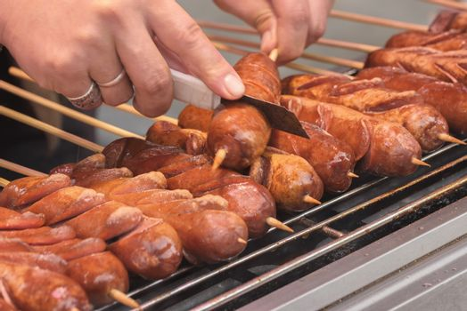 Street food asia. Sausages on a stick. Chinese street food