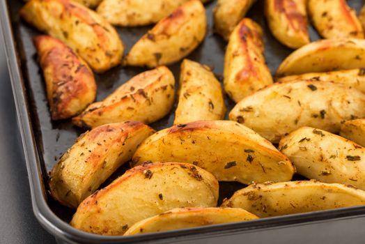 Baked potatoes on baking sheet. Baked potatoes for dinner