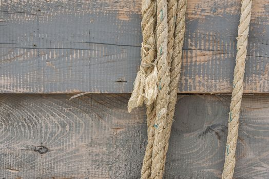 Boards and rope. Ropes on a wooden background