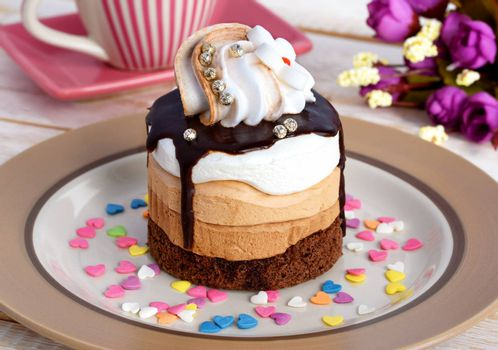 Cake with chocolate. Delicious chocolate cake on plate on table