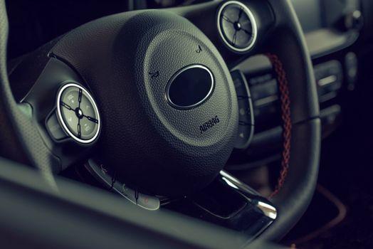 Car rudder close-up. Salon of the black car