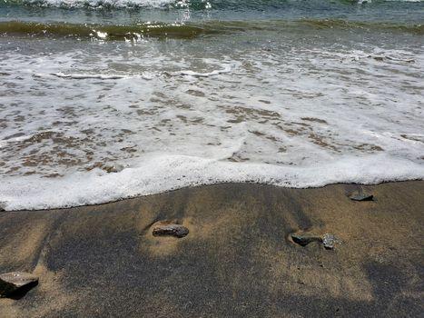 Coal beach pollution. Coal dust. Environmental pollution