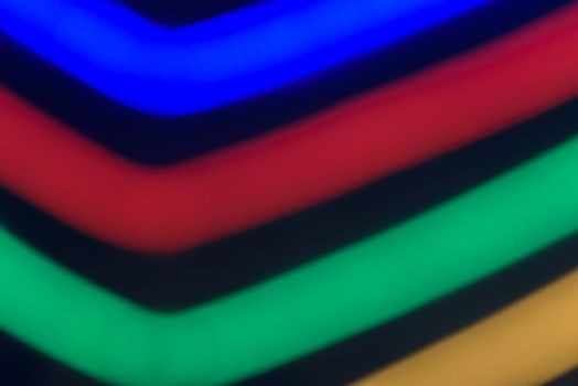 Colorful stripes on a black background. Abstract stripes