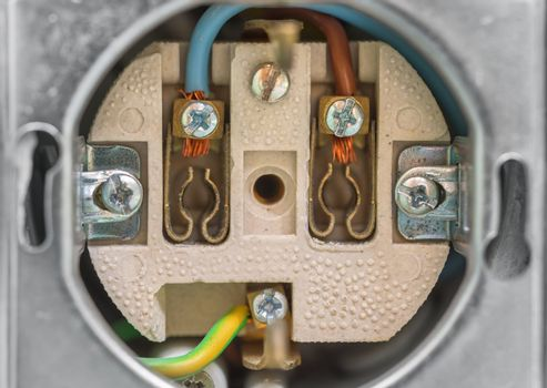 Electrical socket without cover. Close-up of wall socket with grounding pin