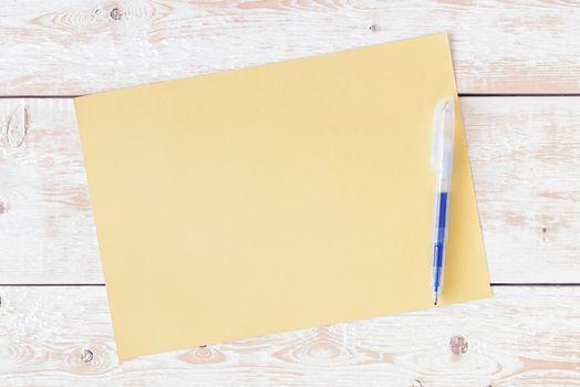 Letter on desk. Blank sheet of paper, pencil on wood background. Design mockup