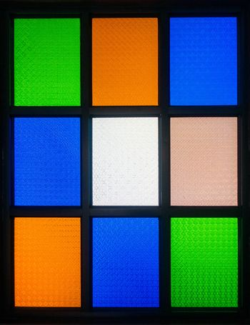 colorful stained glass window with nine boxes