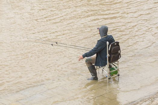 Fisherman on the river. Fishing on the lake
