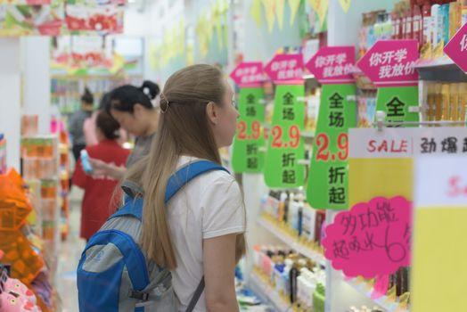 Harbin, Heilongjiang, China - September 2018: Woman shopping