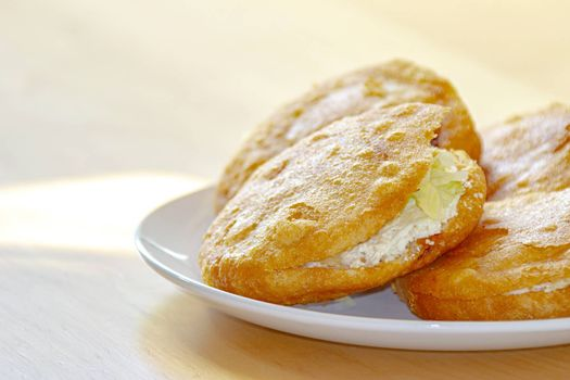 """A close up of a Gordita """"chubby"""" in Spanish is a Mexican cuisine is a pastry made with maize dough and stuffed with cheese, meat, or other fillings."""
