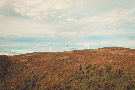 Massive windmills in the top of a mountain range