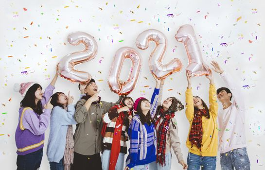 happy young people  gold colored numbers 2021 and celebrating new year holiday