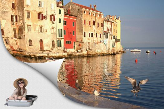 Rovinj harbor in Croatia is on the page with curl effect. Smiling cute little girl is sitting in the travel suitcase smiling at the camera.