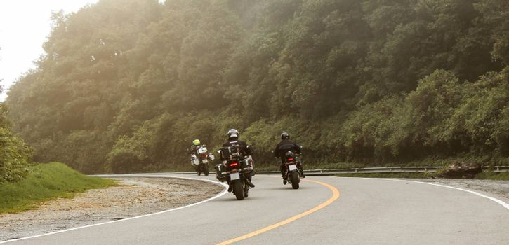 Three bikers riding big bike motorcycle touring on Inthanon National Park, Thailand.