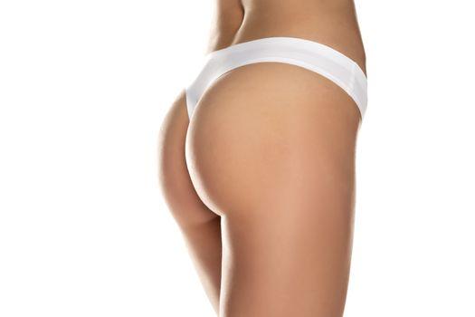 Female bottom with black panties on white