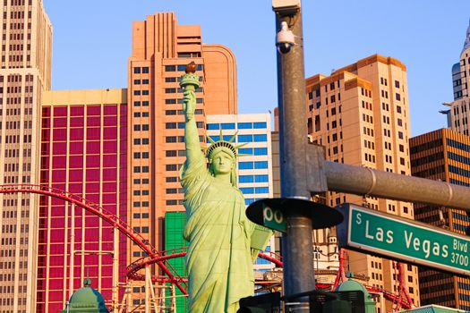 Road sign of Las Vegas BLVD.Street sign of Las vegas Boulevard.Green Las Vegas Sign with Hotel in Background.