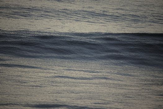 The texture of the rising water wave in the sea at the time of sun rise