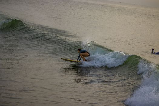Chennai, Tamilnadu -India . September 2, 2020. A foreign girl swimming in the sea on the waves, surfing