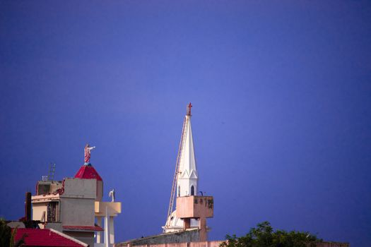 Church steeple against blue skies at chennai in India