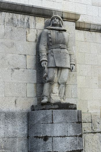 military statues formed with large blocks of stone