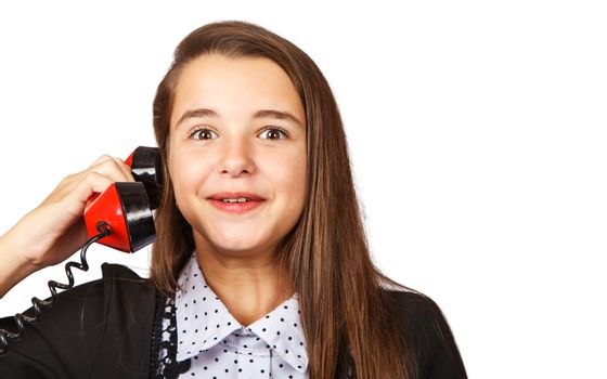 teenage surprised brunette girl talking on red retro telephone closeup on white background