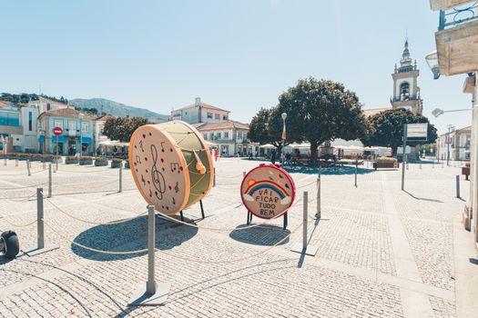 Main plaza of the portuguese village vila nova de cerveira with sculptures in portuguese