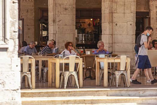 TREVISO, ITALY 13 AUGUST 2020: People sitted at the bar outdoor