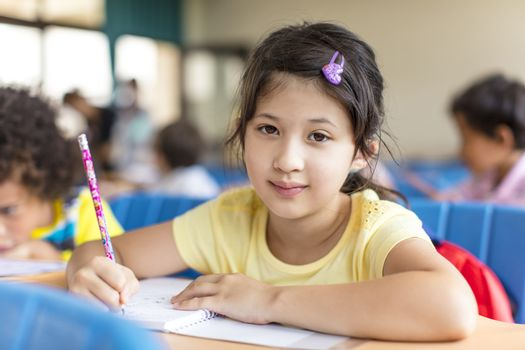 beautiful asian little girl  studying in the classroom.