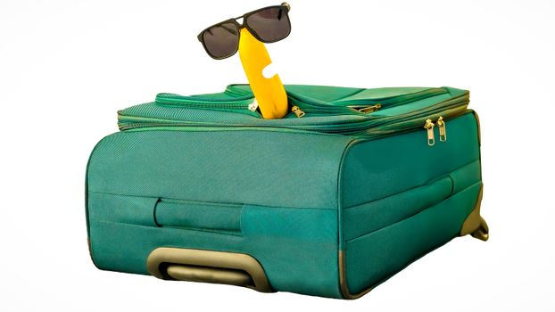 Funny and cheerful banana in sunglasses with suitcase isolated on white background