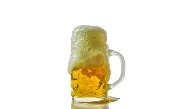 Light beer in a glass with froth isolated on white,close-up