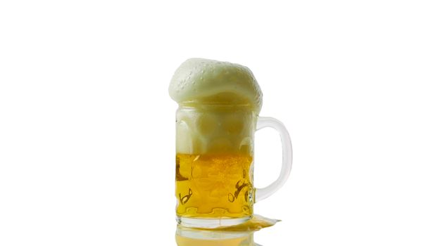 Foamy beer in a glass isolated on white close-up,light beer fresh.