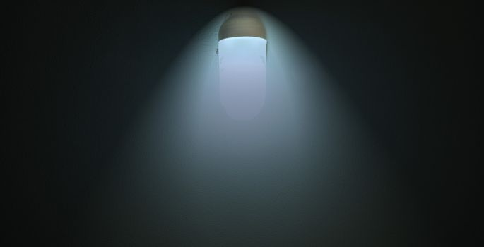 Abstract light bulb beam on cement wall background