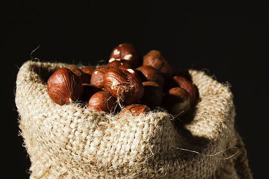 Unpeeled hazelnuts in a bag close up