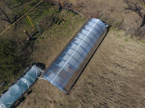 Polycarbonate greenhouse assembled from parts, prefabricated greenhouse. Greenhouse for vegetables.