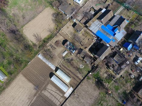 Village view from above, vegetable gardens and gardens in the village, early spring.