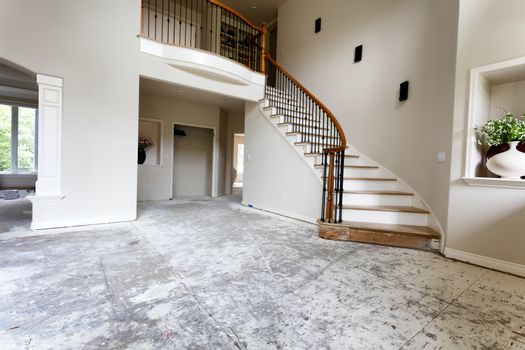 Staircase and floor being remodeled with red oak wood