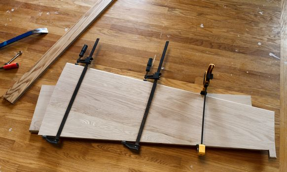 Red oak boards being glued together for staircase treads