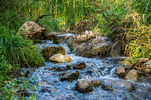 The refreshing flow of natural water resource from a stream