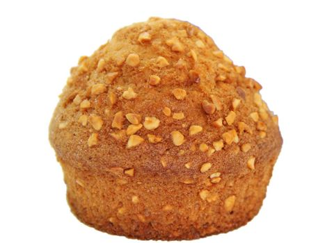 Closeup of a muffin with nuts isolated on white background