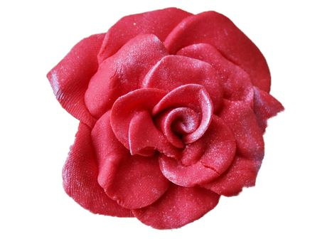Soft focus of a pink gum paste candy rose isolate on white background