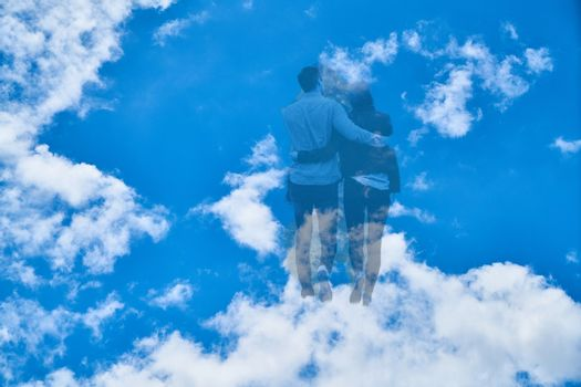 Couple walks to the heavens through the clouds