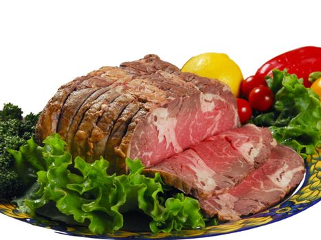 Knuckle ham with fresh salad, broccoli, lemon,California peppers on a plate