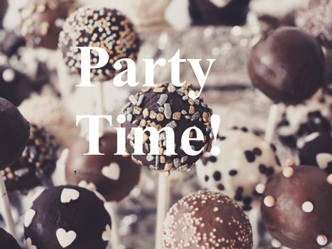 Soft focus of delicious cake pops with PARTY TIME overlay text