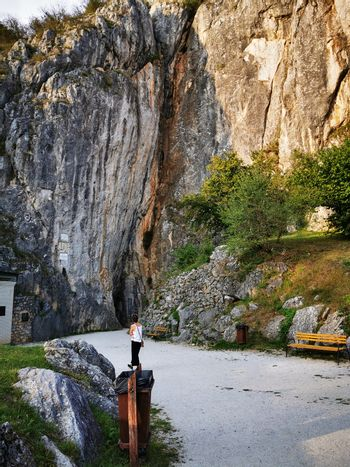 The huge Aggtelek karst, and the entrance to the stalactite cave, and the walking young girl