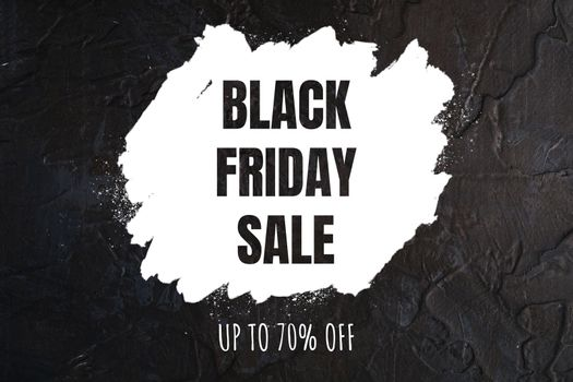 Black Friday sale banner with text up to 70 percent off discount on dark textured background