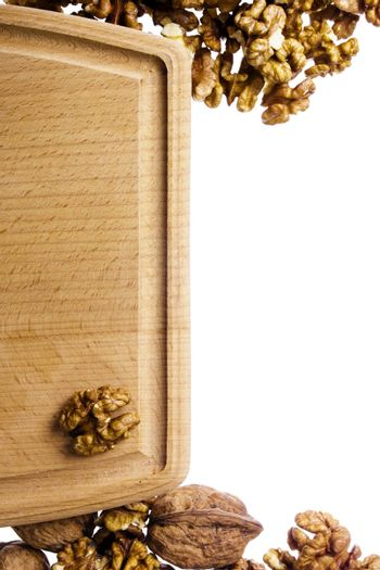 Cutting board and nuts on white background