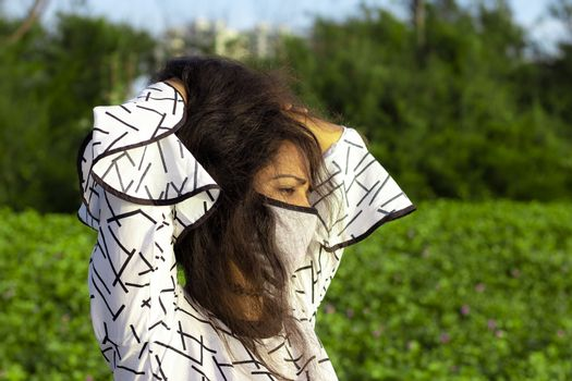 Indian woman wearing home made hygienic face medical mask to prevent infection, illness or flu .Protection against disease, coronavirus.