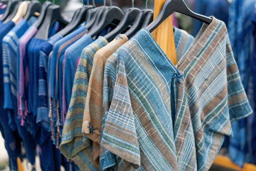 Close up T-shirt Indigo clothing is hand-woven in clothes rack a