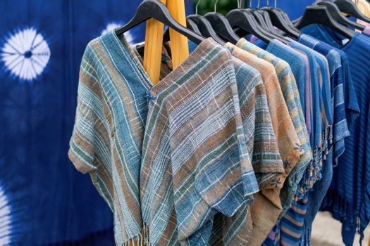Indigo clothing is hand-woven in clothes rack at walking street,
